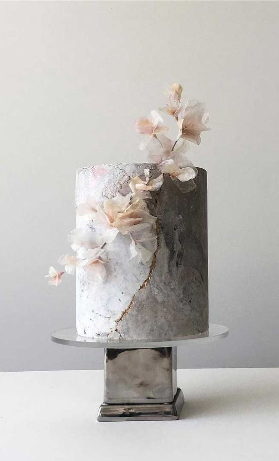 a grey marble wedding cake with gold touches and a blooming branch is an ethereal solution for a modern refined wedding