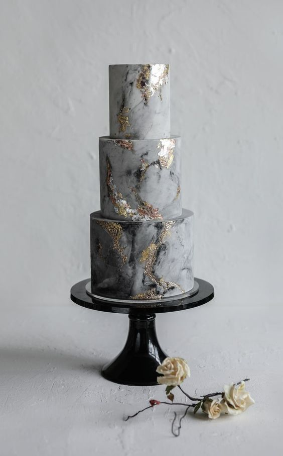 a grey marble wedidng cake with gold touches is a stylish and refined idea for a modern wedding with a whimsy touch