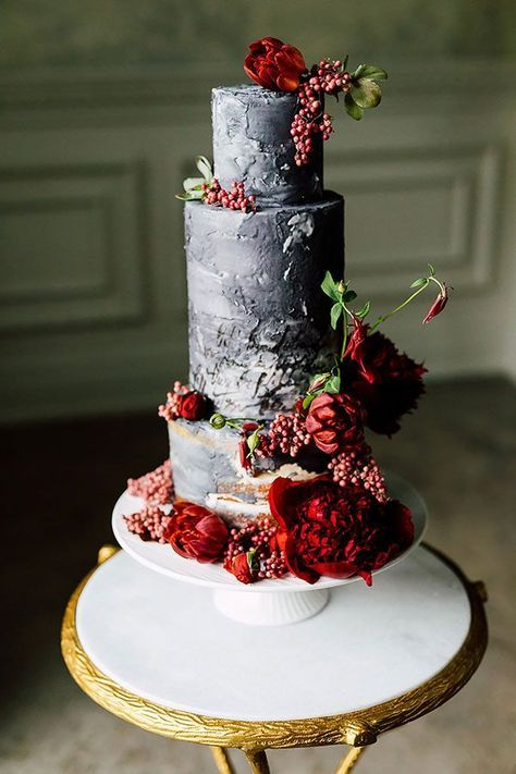 a grey textural wedding cake with deep red blooms and berries is a stylish idea for a whimsical fall wedding