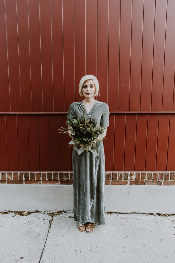 a grey velvet wrap maxi bridesmaid dress with short sleeves and brown strappy shoes for a fall wedding