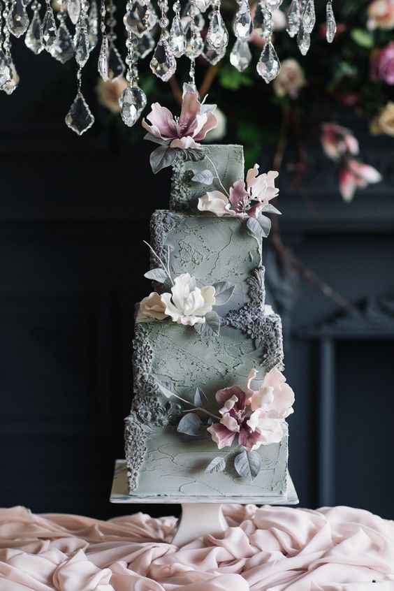 a refined grey textural wedding cake with sugar blooms and leaves is a very sophisticated idea to rock