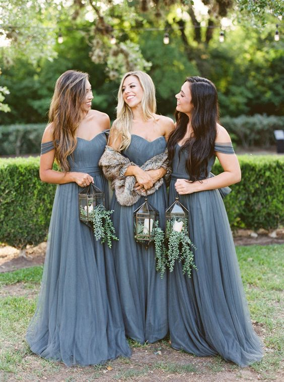 graphite grey off the shoulder maxi bridesmaid dresses with draped bodices, pleated skirts and sashes are chic