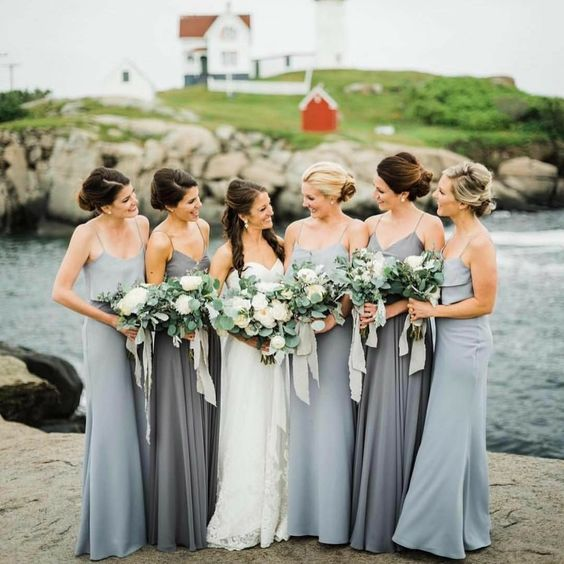 light and usual grey spaghetti strap maxi bridesmaid dresses with tiered bodices are timeless for coastal weddings