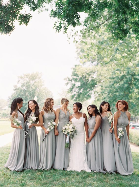 light grey A-line maxi bridesmaid dresses with draped bodices and various necklines plus pleated skirts are chic
