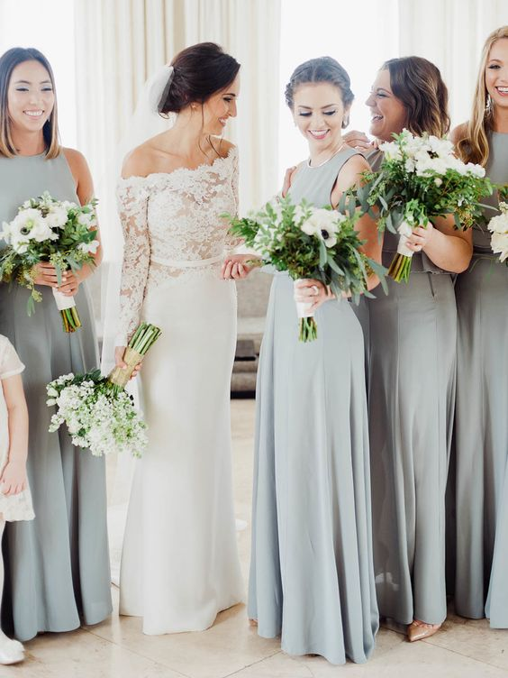 minimalist grey A-line maxi bridesmaid dresses with no sleeves and high necklines plus pleated skirts are super cool