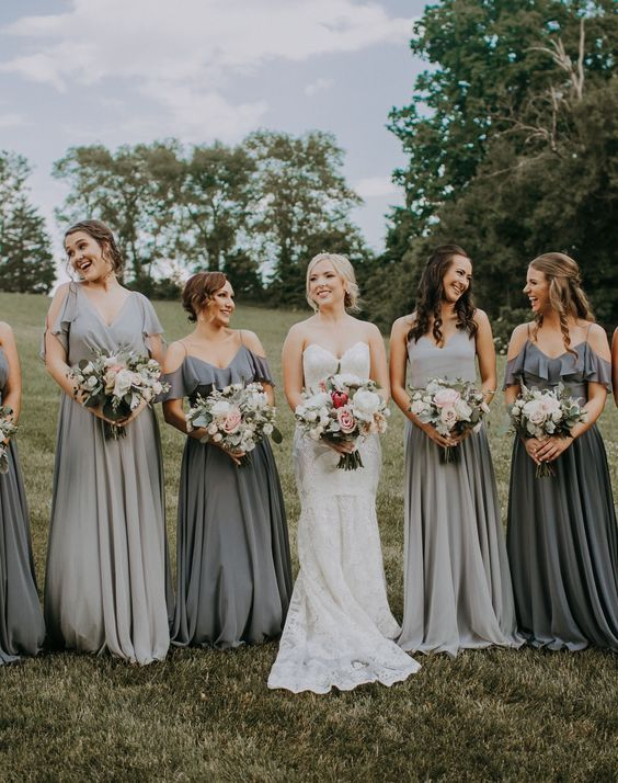 mismatching dove and graphite grey maxi bridesmaid dresses with a cold shoulder and thick straps and V necklines