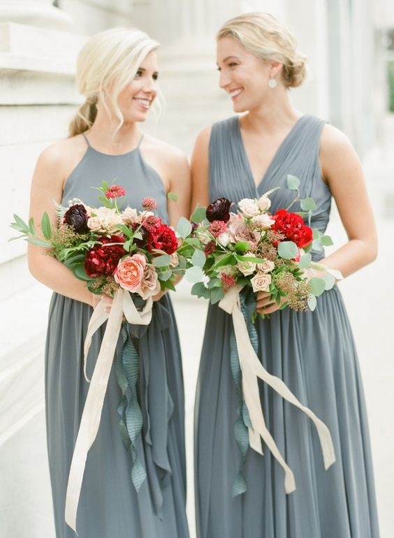 mismatching grey bridesmaid dresses with a halter and a V-neckline, with a draped bodice and pleated skirts