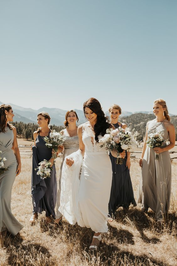 mismatching light grey and graphite grey maxi bridesmaid dresses, with draperies and without for a summer wedding
