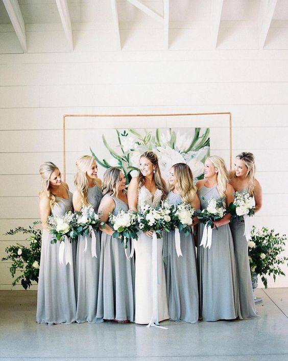 sleeveless light grey maxi bridesmaid dresses with draped and embellished bodices for a spring wedding
