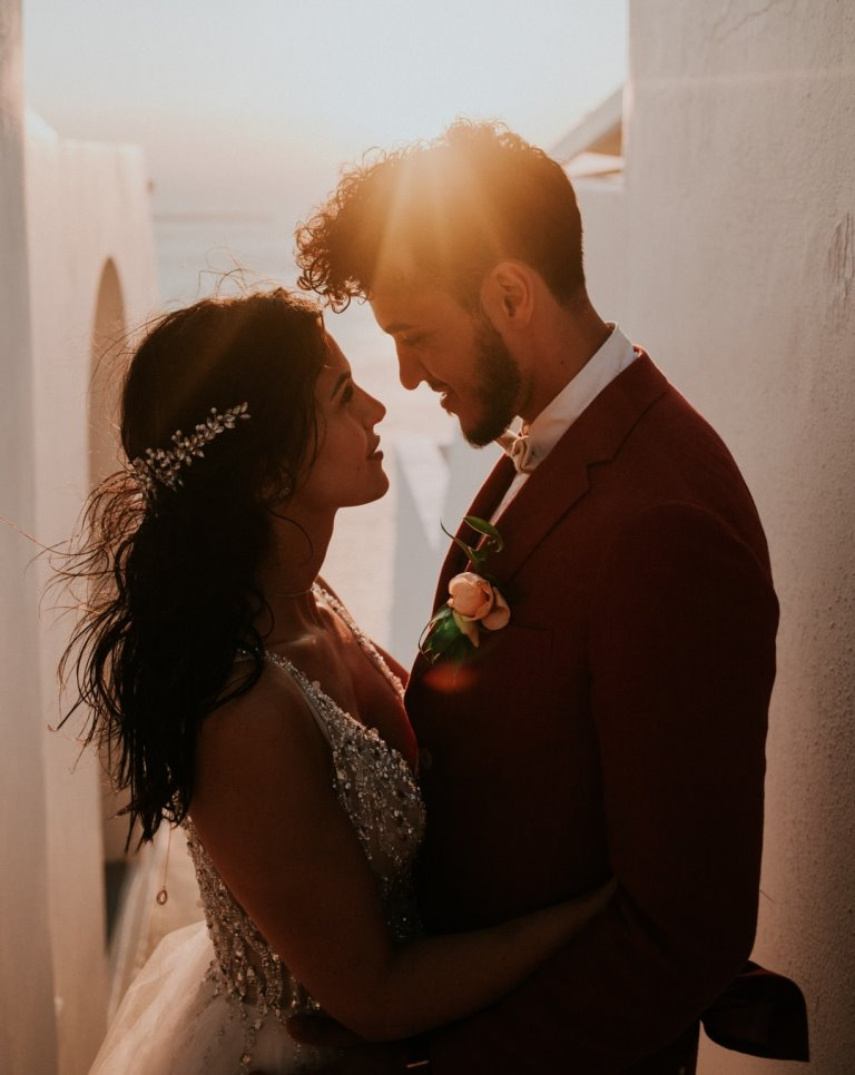 This couple went for a lovely destination Santorini wedding with glam decor and adorable looks