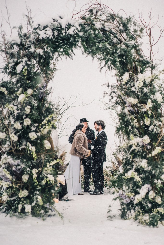 The first wedding arch was a greenery and white bloom one, with twigs and lots of snow