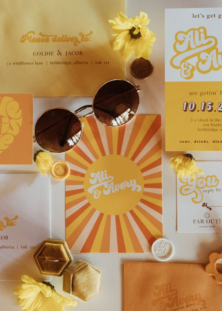 The wedding invitation suite was done in orange, yellow and rust and fully reflected the color scheme