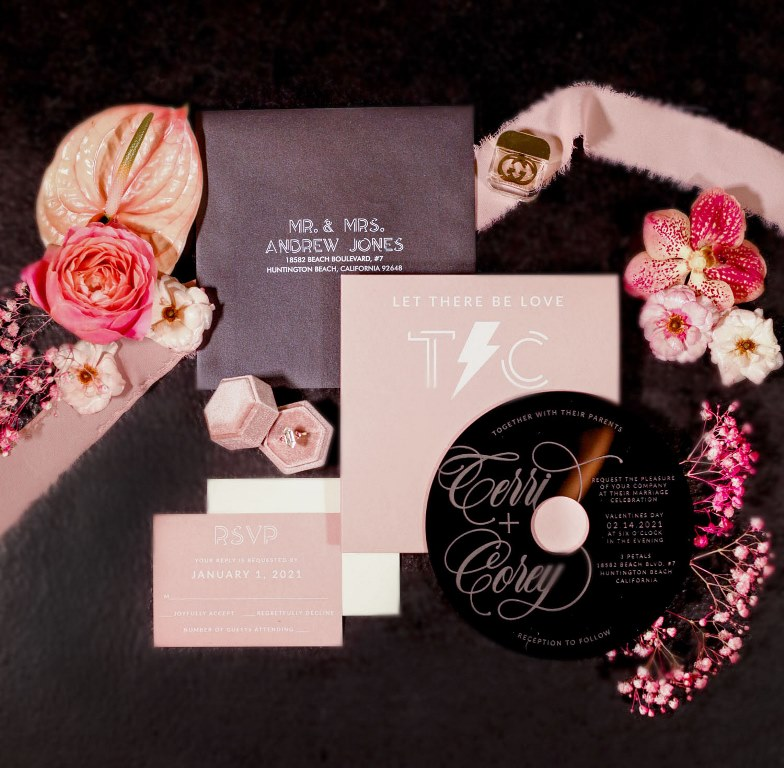 The wedding stationery was done in blush, black and purple
