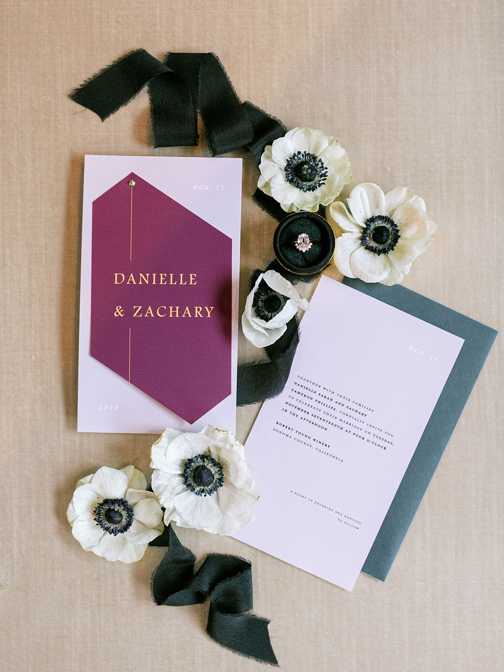 The wedding stationery was done in neutrals, green and purple, with gold printing