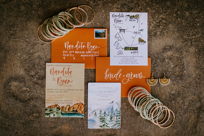 The wedding stationery was done with rust envelopes, beautiful painted mountain landscapes
