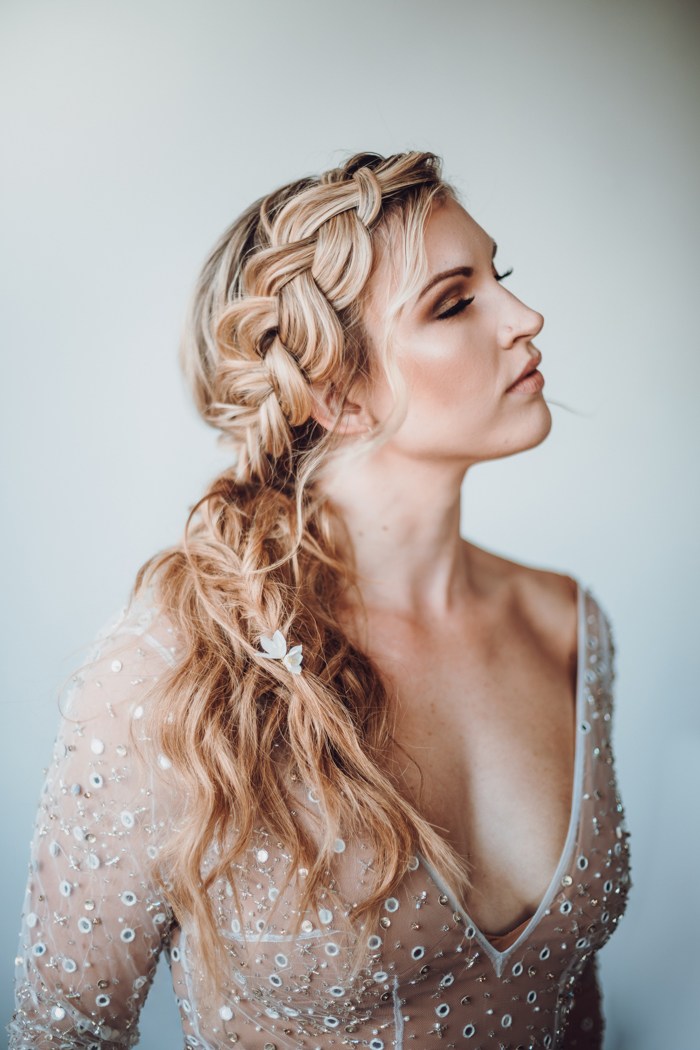 One bride was wearing a lovely braided half updo and a gorgeous shiny wedding gown