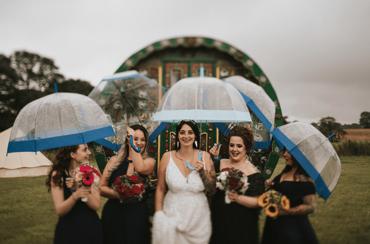The bridesmaids were wearing mismatching black bridesmaid dresses