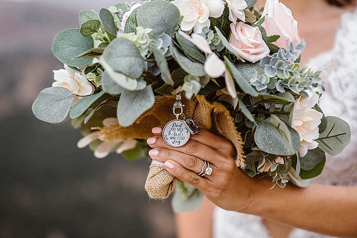 The wedding bouquet was done with white and blush blooms and pale greenery
