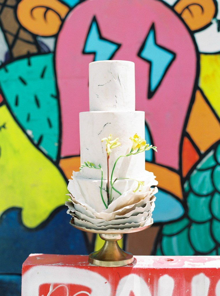 The wedding cake was white, with ruffle tiers and some yellow blooms to keep up the vibe of the wedding