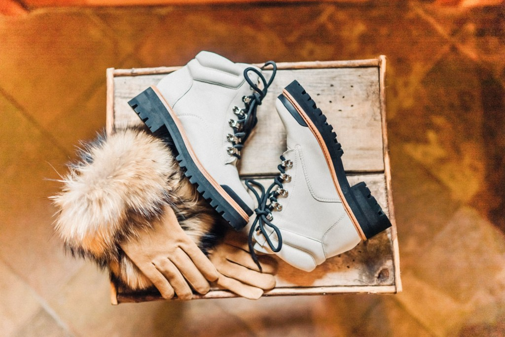 Furry gloves and white hikin boots are great accessories to make a winter bride feel comfy