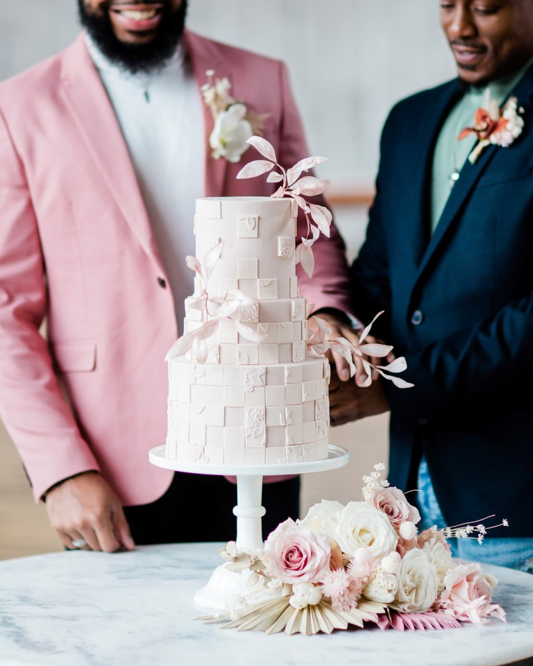 The wedding cake was a blush masterpiece, with textural and sculptural detailing, sugar leaves