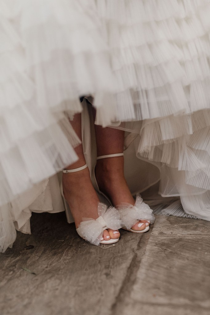 The wedding shoes were white ones, with pretty polka dot bows on top
