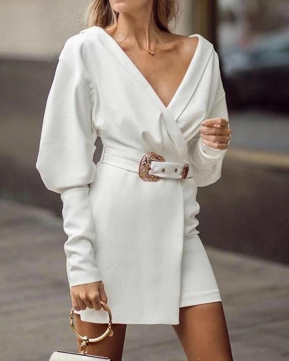 a white off the shoulder blazer mini dress with a matching belt with a copper buckle is a lovely piece to wear to a city hall wedding