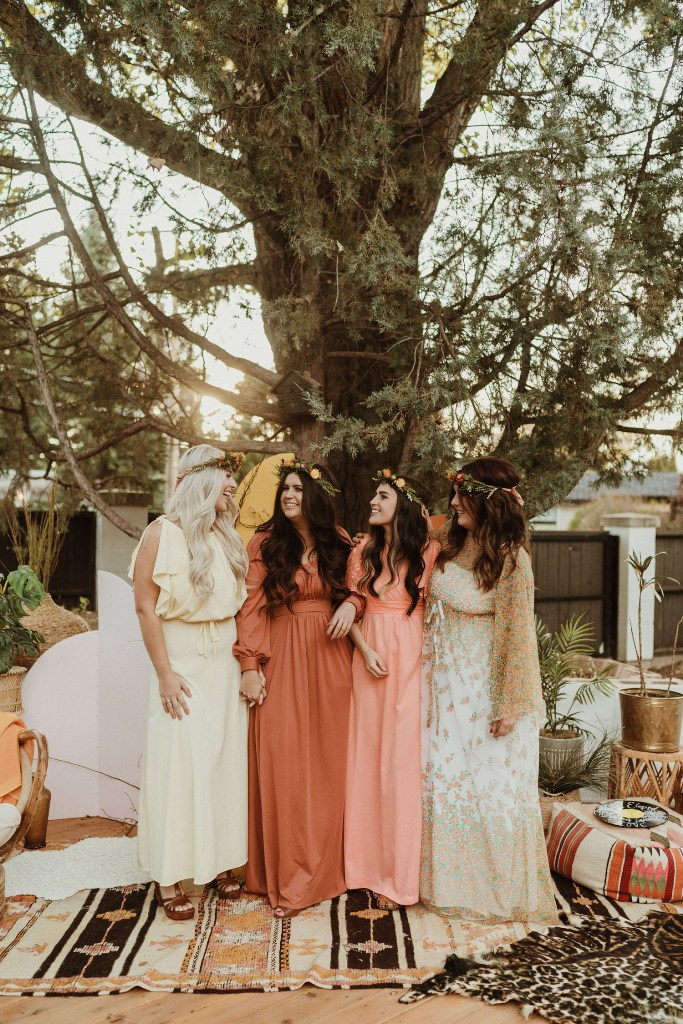 The bridesmaids were wearing sunset-inspired high waisted dresses and floral crowns