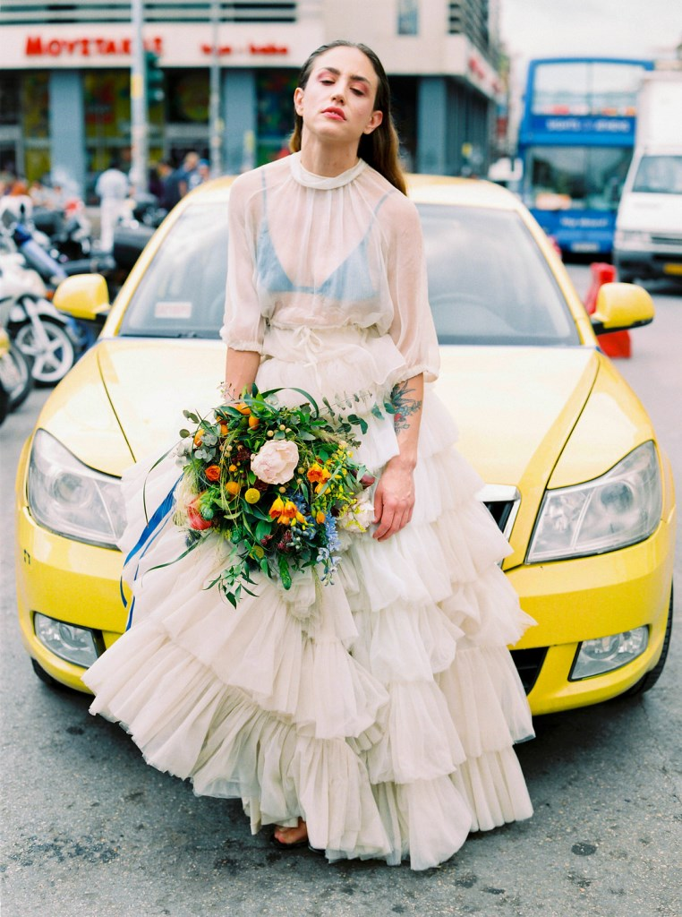 The wedding bouquet was bright and colorful, with blue, pink, orange and yellow blooms