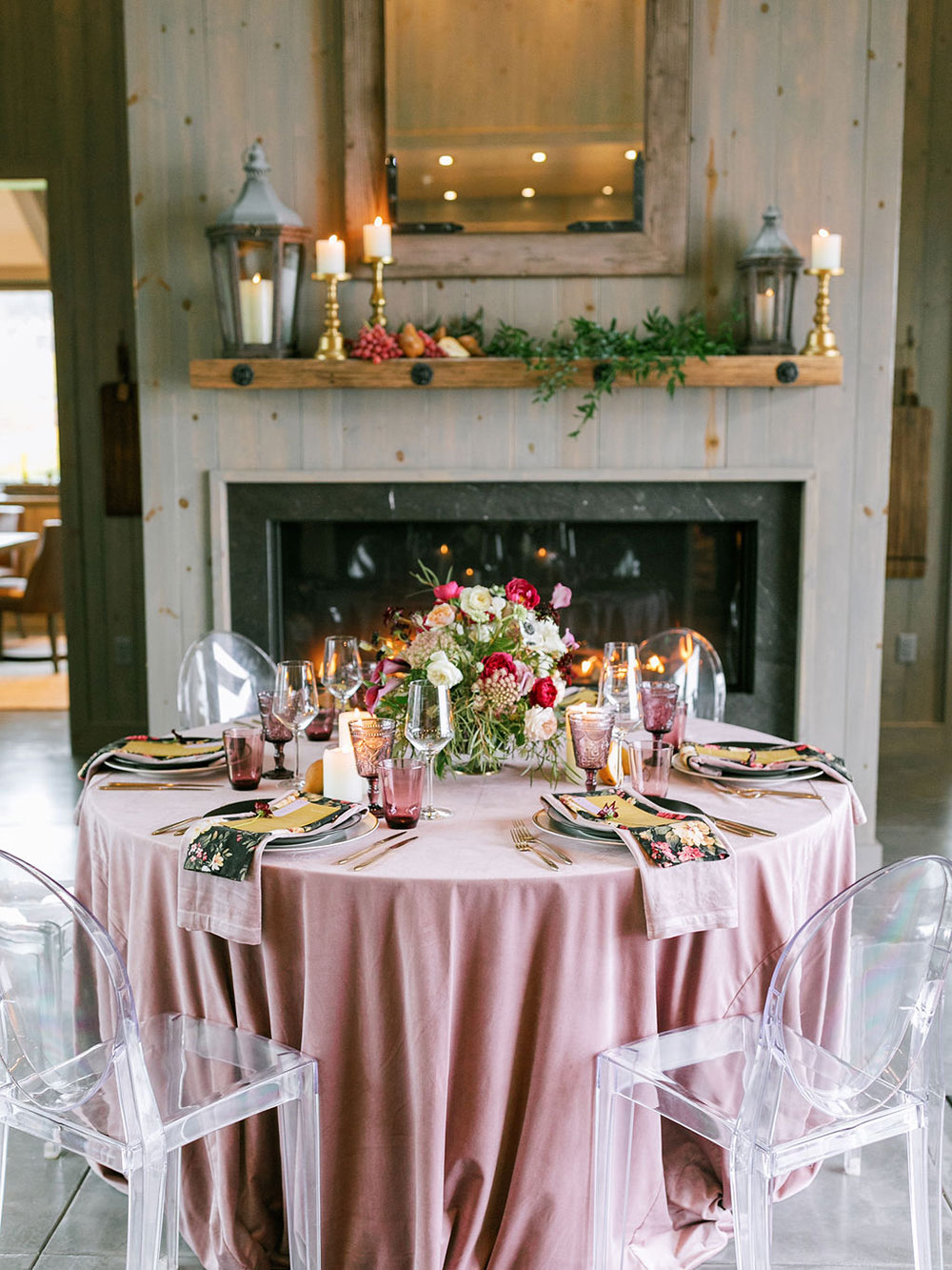 There was a small round table styled for the shoot with pink and floral linens, a bright centerpiece and colored glasses