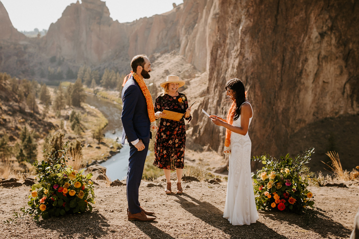 There were some florals and greenery decorating the ceremony space and an amazing landscape as a backdrop