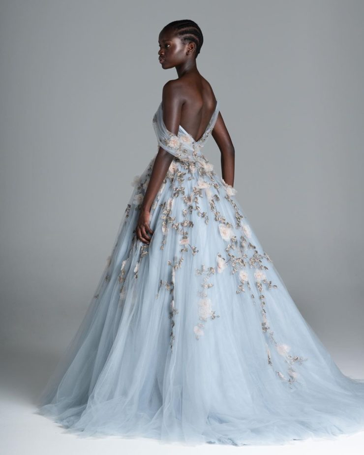 a blue wedding ballgown with blush floral emboirdery, an open back for a formal and very refined wedding