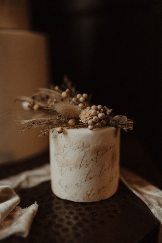 a buttercream wedding cake with handpainted quotes, dried blooms and grasses is ethereal and exquisite
