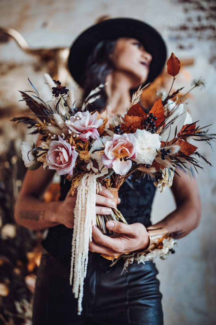 The gals were carrying mismatching wedding bouquets composed of pink blooms, dried blooms and foliage and berries