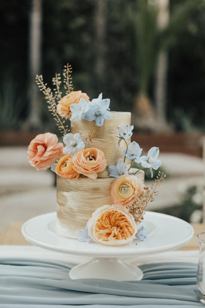 06 The wedding cake was a brushstroke gold one, with orange and blue blooms and gilded branches