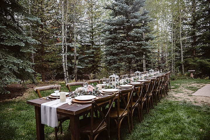 The wedding reception was done outdoors, in the backyard, which looked very woodland-like