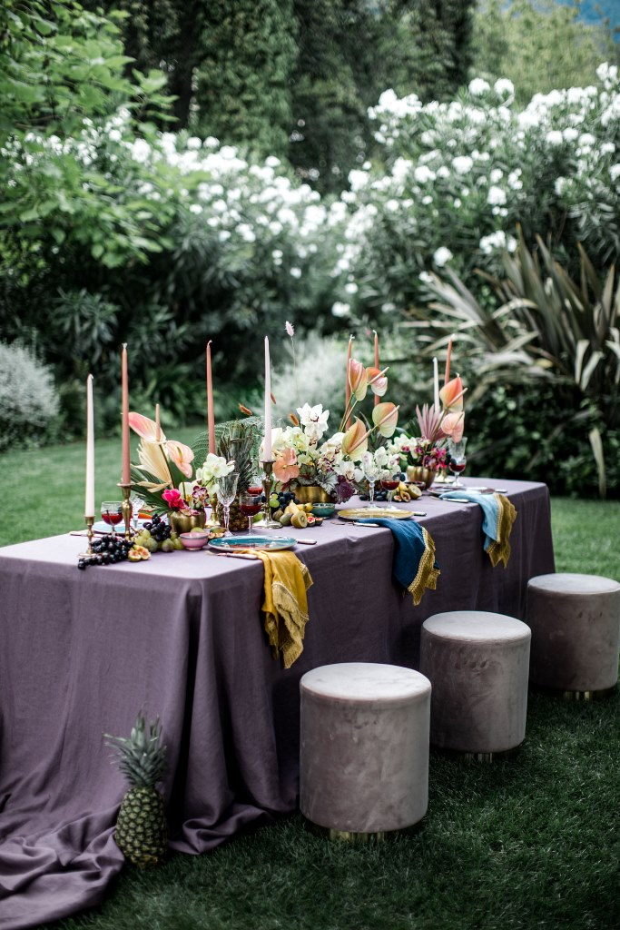 The wedding tablescape was done bright, fun and cheerful, with delicious fruit for a decadent feel