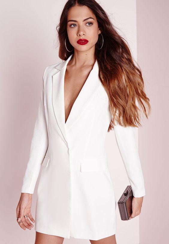 a minimalist white mini tux dress, statement accessories, a red lip and a shiny mini clutch for a minimalist bride