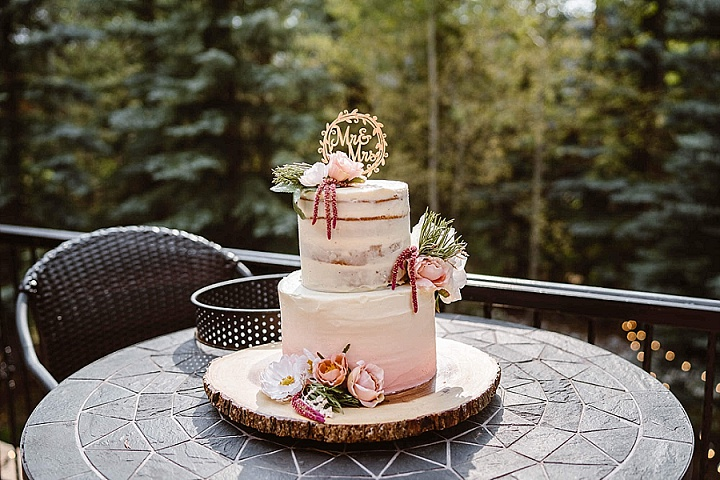 The wedding cake was a naked ombre one, with pink touches and blush blooms, with a calligraphy topper