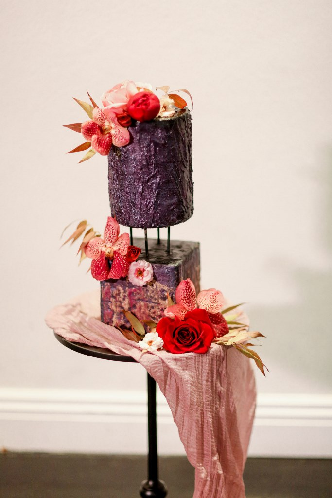 The wedding cake was composed of two parts and was done with a Gothic vibe plus bold florals