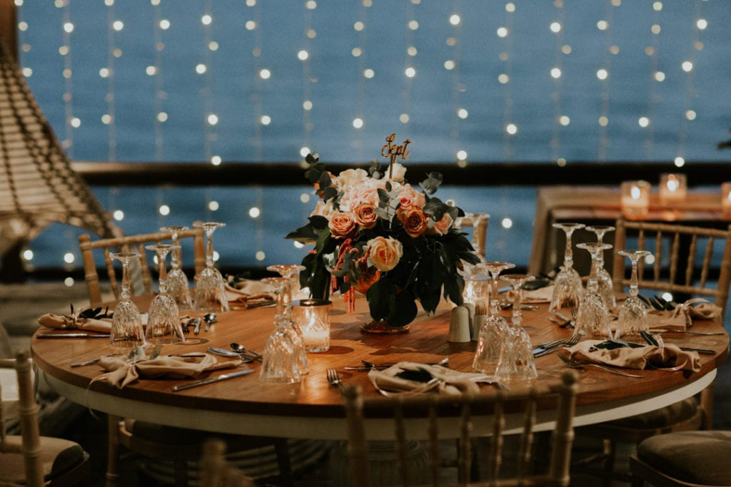 The wedding tablescapes were done with cool floral arrangements and candles, the reception didn't require much decor