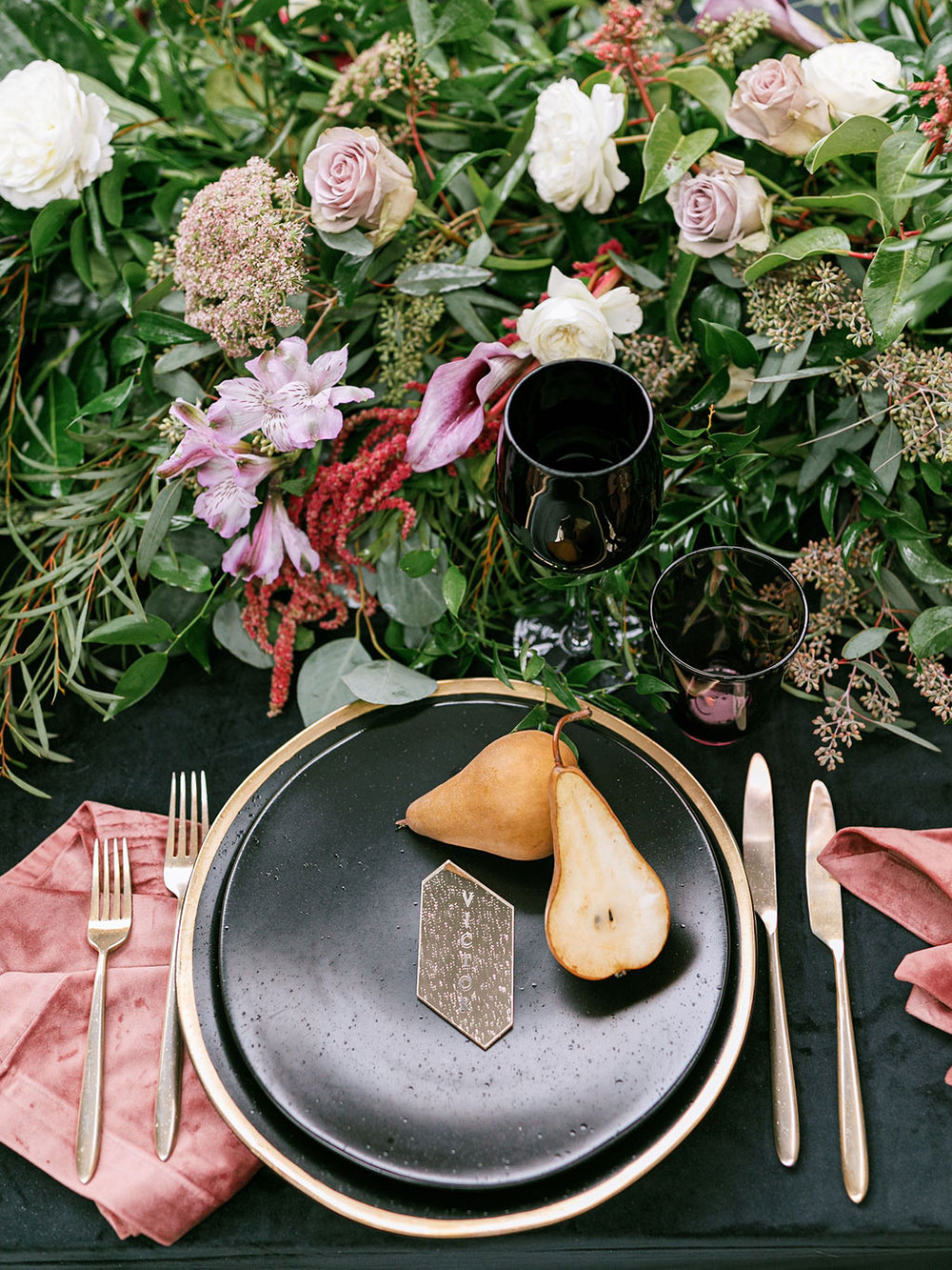 Fresh pears were added to each place setting and gold cutlery was included