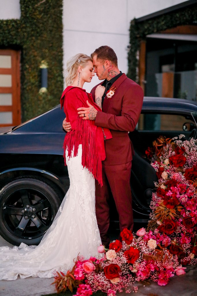 The bride covered up with a red fringe jacket to highlight her romantic look