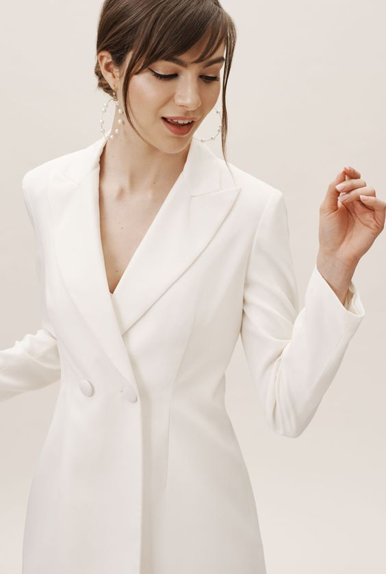 a perfect minimalist white blazer dress and pearl hoop earrings for a super trendy and bold bridal look
