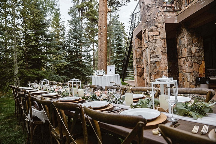 The table was decorated with blush and white blooms, greenery and candle lanterns