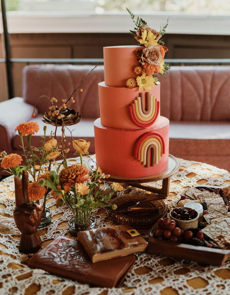 The wedding cake was a coral one, with bright blooms and bold detailing, there was a small cheese board with crackers and fresh fruit