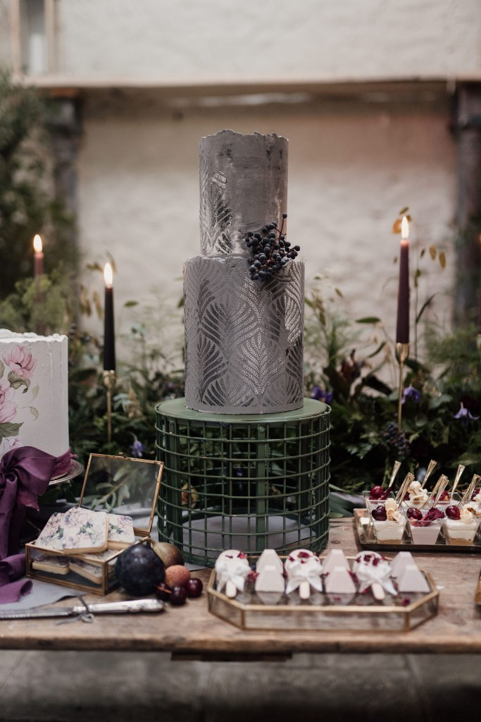 The wedding dessert table showed off a grey and silver wedding cake and lots of adorable desserts