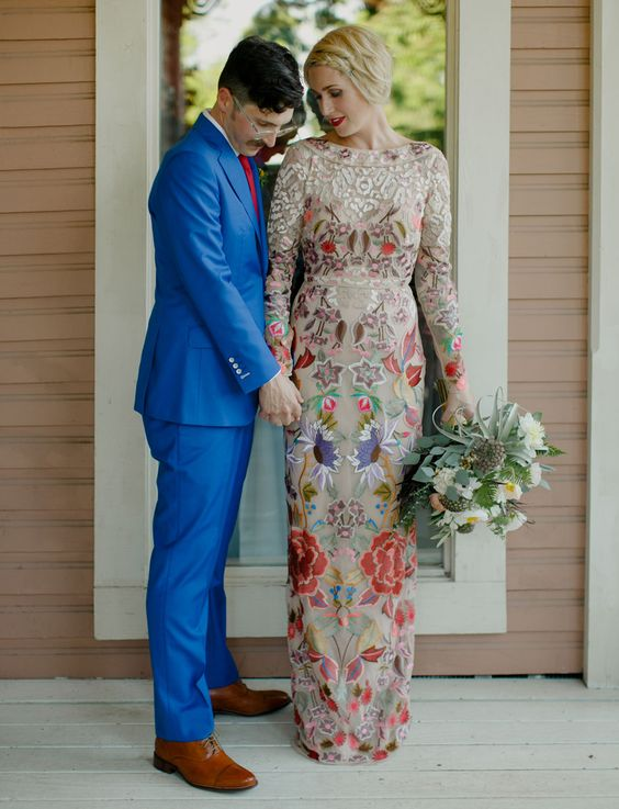 a colorful sheath wedding dress with a high neckline, long sleeves and lace appliques and embroidery