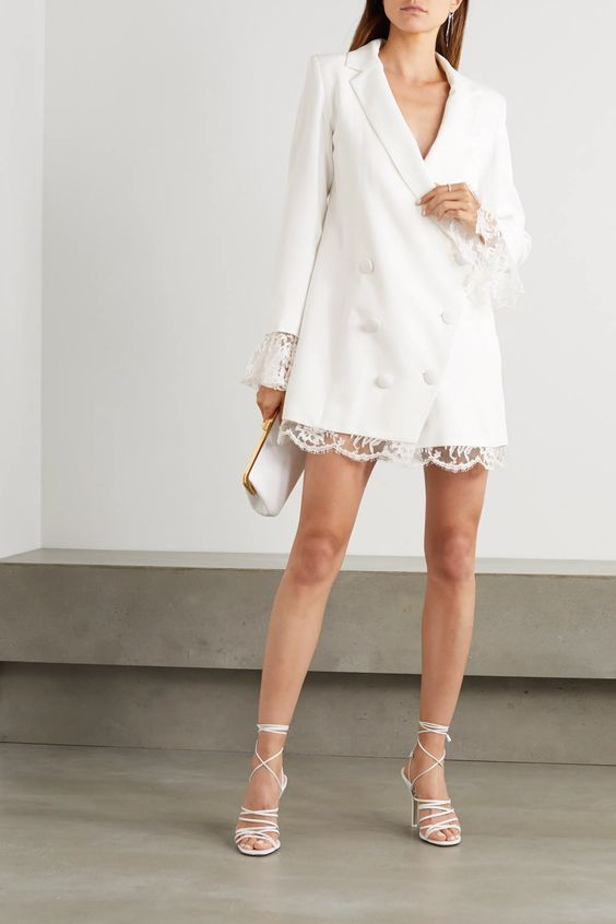 an oversized white blazer mini dress with a lace edge, strappy heels and a mini clutch for a modern bride