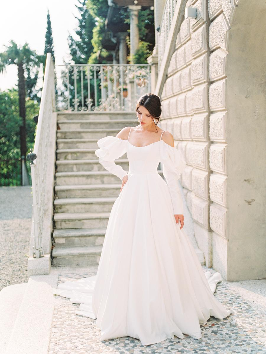 a wedding ballgown with off the shoulder puff sleeves, spaghetti straps and a train is adorable and comfy to wear